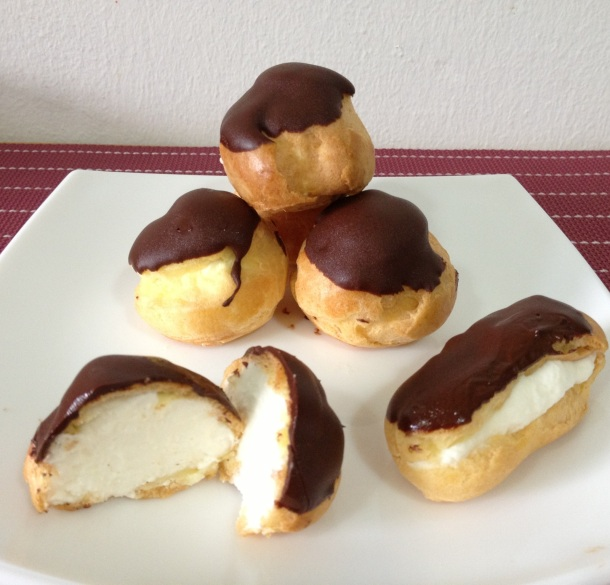Profiteroles and eclairs filled with creme Chantilly and finished with dark chocolate